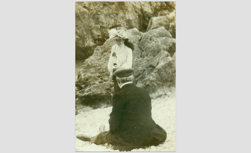 Dorothy Theomin. As a young woman (smiling) with her father on a beach.