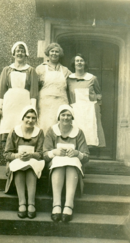 This undated photograph shows Miss E. Barr (centre back), a, cook for nine years in the 1930s. Housemaid Miss M Byrne is on her left. Seated on the left was Miss Ethel Massey (nee Wilson) who was also employed as a housemaid between 1930 and 1939. Does anyone recognise the other staff?