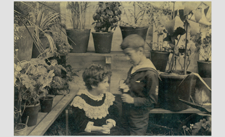 Edward and Dorothy Theomin in a greenhouse.