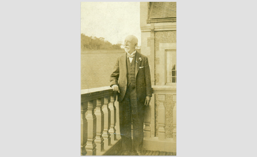 David Theomin, late 70's in age. At Olveston on the balcony off the sitting room. 'S506' Kodak print. (Passed on by Margery Blackman from Mr John F Walker, custodian at Olveston 1967-1971).