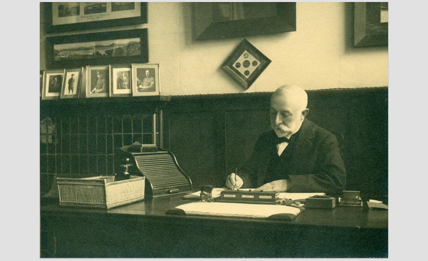 David Theomin sitting at his desk.